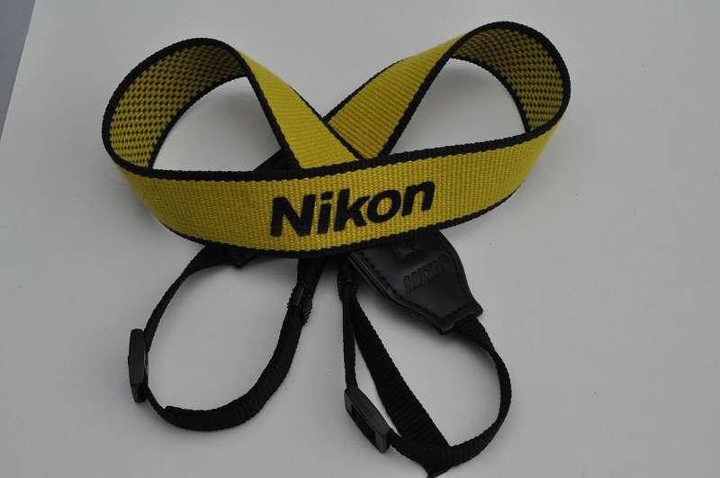 Nikon Schulterriemen Gelb schwarzer Schriftzug - Zustand A/A+